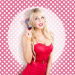 Stock Photo: Polka dot pinup girl in retro rockabilly fashion
