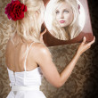 Dreamy woman looking at mirror reflection — Stockfoto