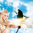 Romantic goddess of love shooting magic rose — Stock Photo