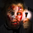 Stock Photo: Scary zombie with Halloween idelight bulb