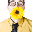 Man with flower in mouth — Stock Photo