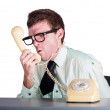 Angry businessman yelling down phone — Stock Photo