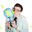 Isolated businessman holding world globe - Stockfoto