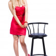 Woman next to bar stool — Stockfoto