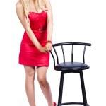 Woman next to bar stool — Stock Photo
