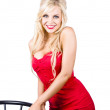 Smiling woman in red dress — Stock fotografie