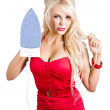 Fashionable woman with iron — Stock Photo
