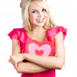 Stock Photo: Woman cuddling love heart sign