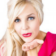 Стоковое фото: Blonde female lover blowing kiss
