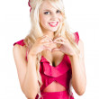 Blonde woman making heart shape — Stock Photo