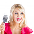 Surprised woman with pinup hair brush — Stock Photo