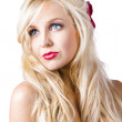 Dreamy blond girl with faraway expression — Stock Photo #26191309