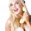 Stock Photo: Gorgeous blond woman laughing on telephone call
