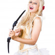 Blond beauty cupid firing love arrow — Stock Photo