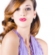Beautiful woman puckering lips for kiss - Stock Photo