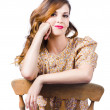 Stylish girl at rest on antique chair — Stock Photo