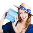 Pin up woman with blue polkadot gift — Stock Photo