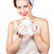 Retro housewife with teapot — Stockfoto