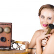 Woman with antique telephone — Stockfoto