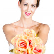 Beautiful woman holding florist flowers — Stock Photo