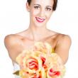 Beautiful woman holding florist flowers — Stock Photo