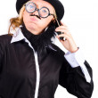 Unhappy business man talking on phone — Stockfoto