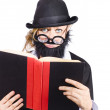 Stock Photo: Nutty scientific professor reading book