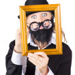Woman with empty picture frame — Stock Photo