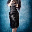 Stock Photo: Gothic female fashion model. Elegant black outfit