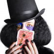 Joker with burnt playing card — Stock Photo