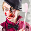 Stock Photo: Zombie with big toothbrush. Fear of dentist