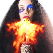 Woman breathing fire from mouth — Stock Photo