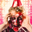Zombie in party hat. Halloween party celebration — Stock Photo