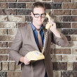 Humorous male nerd chatting business on phone — Stock fotografie #26191797