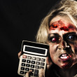 Business woman with calculator. Halloween sale — Stock Photo