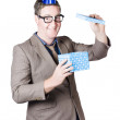 Nerd man with happy birthday present — Stock Photo