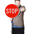 Isolated man holding red traffic stop sign — Stock Photo
