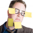 Funny man with yellow sticky notes on face — Stock Photo