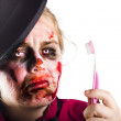 Zombie woman with toothbrush — Stock Photo