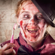 Stock Photo: Zombie at dentist holding toothbrush. Tooth decay