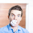 Stressed male office employee eating big workload — Stock Photo #26192009