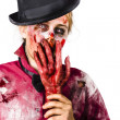 Stock Photo: Shocked zombie holding severed hand. Dead silence