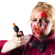 Stock Photo: Criminal zombie pointing revolver