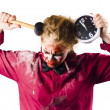 Late zombie with clock and hammer. Halloween time — Stock fotografie