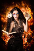 Sorcerer casting black magic spells of fire — Stock Photo