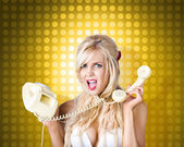Blonde girl tangled in a funny phone communication — Stock Photo