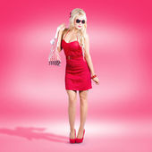 Shop till you drop. Female retail shopper in red — Stock Photo