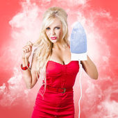 Smoking hot blond cleaning woman with red hot iron — Stock Photo