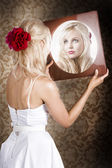 Dreamy woman looking at mirror reflection — Stock Photo