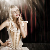 Cabaret showgirl on smoky theater stage — Stock Photo
